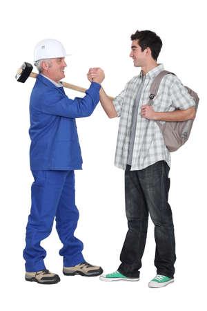 Tradesman making a pact Stock Photo - 15832945
