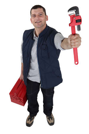 class maintenance: A manual worker holding a wrench