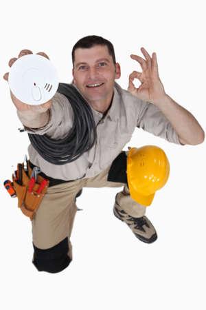 smoke alarm: Electrician with a smoke alarm Stock Photo