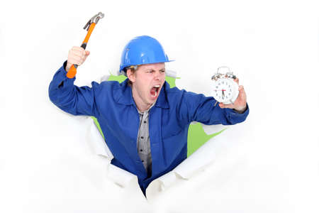deranged: Angry man holding a hammer and an alarm clock Stock Photo