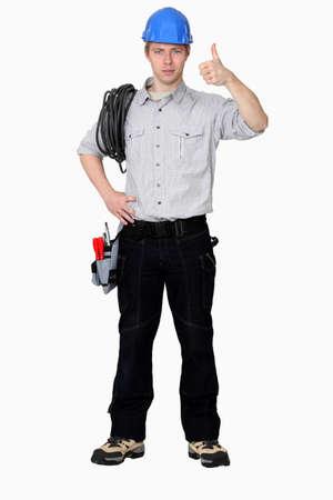 convinced: Tradesman giving the thumb Stock Photo