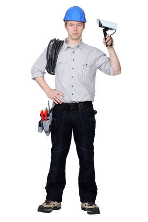 security equipment: Electrician installing CCTV system Stock Photo