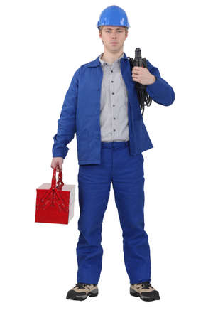 journeyman technician: Electrician carrying cable and tool box