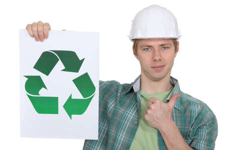 promoting: A female construction worker promoting recycling  Stock Photo