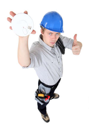 Tradesman approving of the use of smoke detectors Stock Photo - 15832695