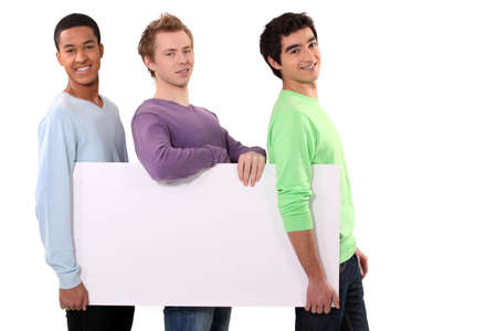 divulge: Three friends holding blank poster