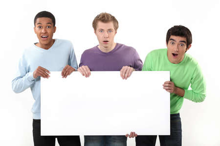 Three surprised men holding poster photo