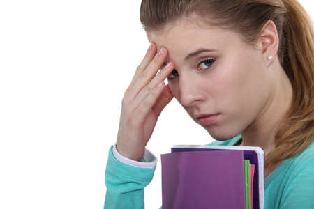 manage clutter: Stressed student worried about exams