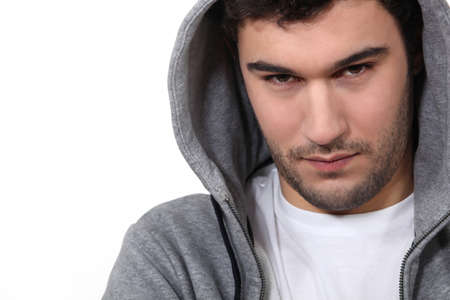 hooded top: Young man in a hooded top Stock Photo