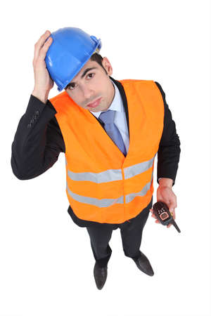 vest: An overwhelmed engineer trying to be a traffic guard Stock Photo