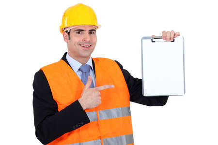 businessman wearing helmet and holding a notepad Stock Photo - 15832762