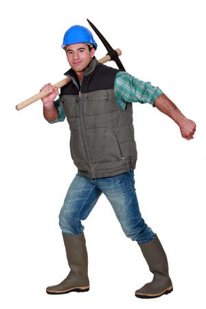 mattock: Worker with a pickaxe Stock Photo