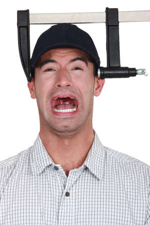 clamps: A man with a clamp on his head