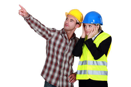 woe: Architect and foreman looking at a problem