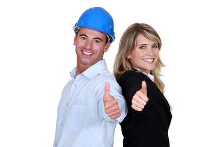 non verbal communication: Engineer and a tradesman giving the thumb