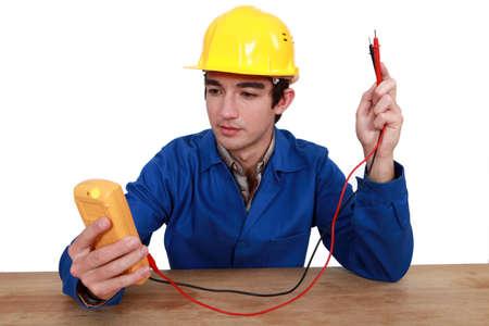 electricista con un comprobador Foto de archivo - 15832916