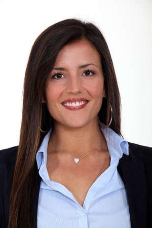 all smiles: portrait of brunet businesswoman all smiles against white background