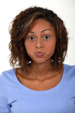 average woman: young woman pouting Stock Photo