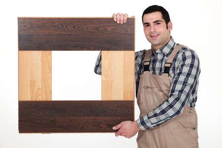 accommodate: Man with parquet slats Stock Photo