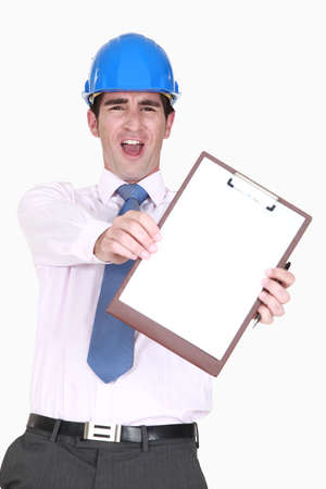 Ecstatic man in a hardhat with a blank clipboard photo