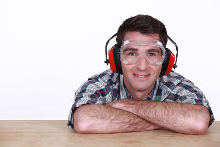 eye protectors: Man wearing goggles and hearing protection