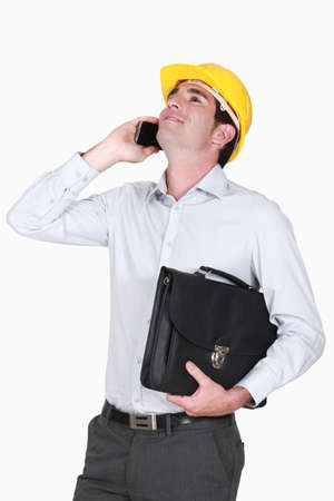 architect on the phone holding briefcase photo