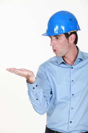 puckering lips: Engineer blowing an invisible object