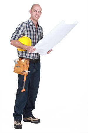 full-length shot of carpenter consulting blueprints photo