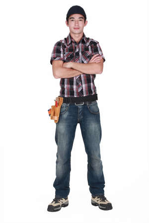 Young builder stood with arms folded photo