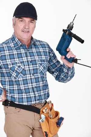 machine man: Man holding a power tool
