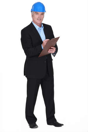 blue collar: portrait of middle-aged architect holding clipboard