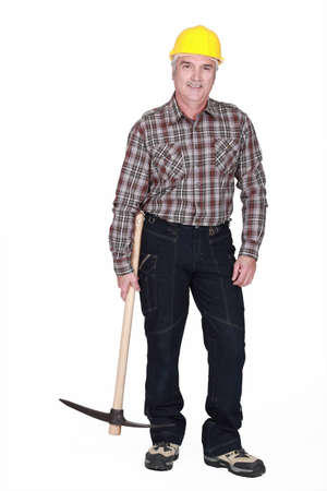 Middle-aged man with pick-axe photo