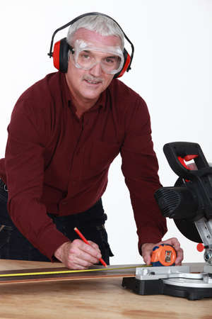 Man with a rotary saw photo