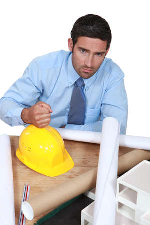 cross ties: Architect with his fist on a hard hat Stock Photo