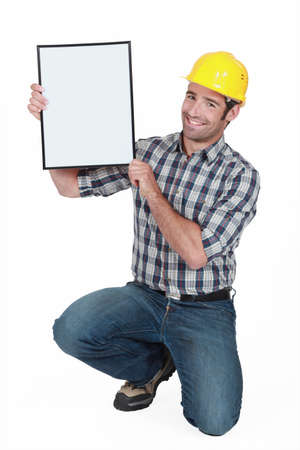 Manual worker holding a blank poster  photo