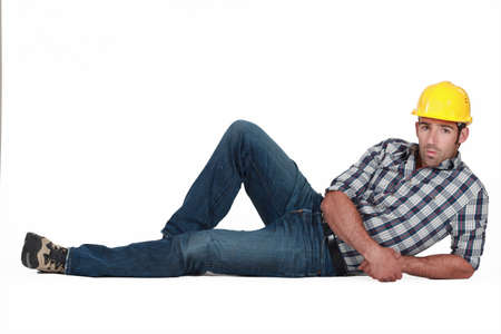 manly man: Attractive construction worker lying down