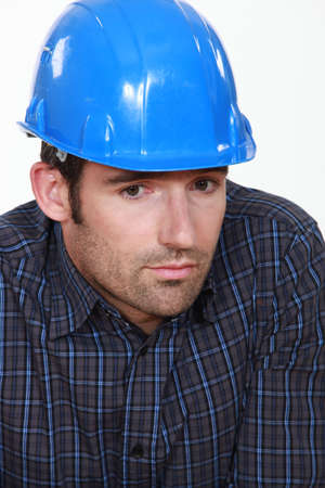 dismayed: Portrait of tradesman lacking self-confidence Stock Photo