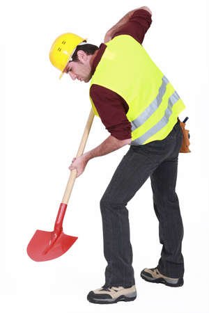 dug: Worker digging with a shovel