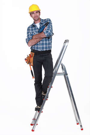 stepladder: Tradesman standing on the steps of a stepladder Stock Photo