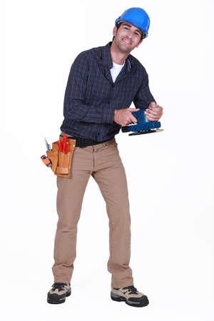 sander: Man using power sander