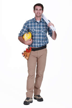 tradesmen: Tradesman holding rolled-up drawings, tools and equipment Stock Photo
