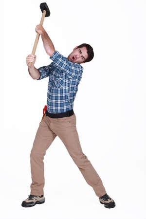 sledge hammer: Man using sledge-hammer
