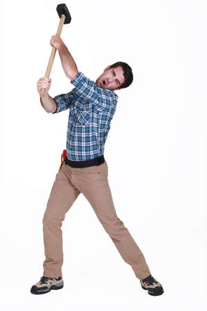 Man using sledge-hammer Stock Photo