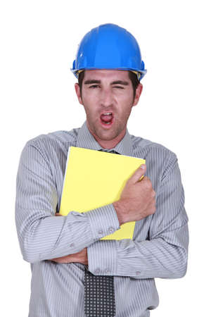 clutching: Man yawning whilst clutching paperwork
