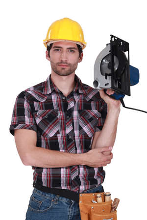 grudging: Man holding a hand-held cold saw