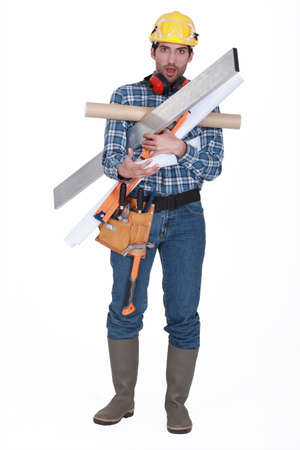 burdened: Man burdened by his tools Stock Photo