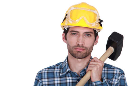 construction crew: Attractive construction worker with a sledgehammer