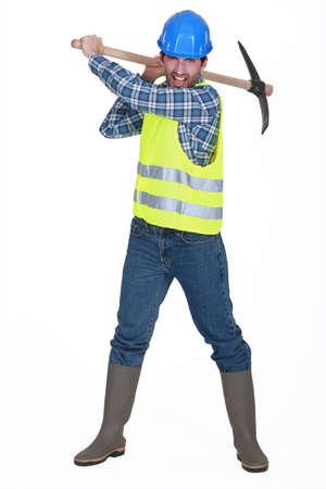 mattock: A man construction worker with a pickaxe