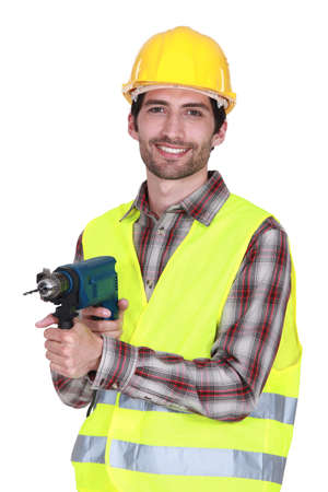 tools belt: Construction worker with a power drill