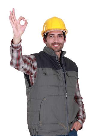 assent: portrait of foreman making okay sign